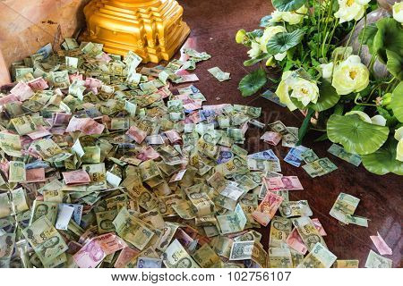 Thai currency offerings in the Buddhist temple of Chalong in Phuket, Thailand