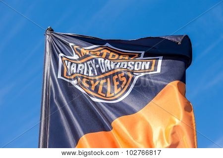 Flag With Emblem Of A Motorcycle Harley Davidson Closeup