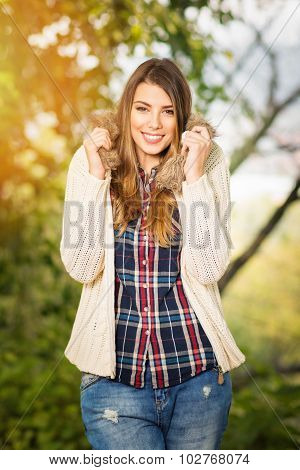 Beautiful young blonde woman in autumn outfit