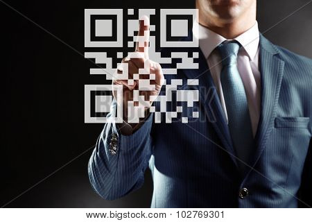 Man presses on QR code