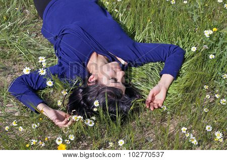 Young Woman Lying In A Meadow