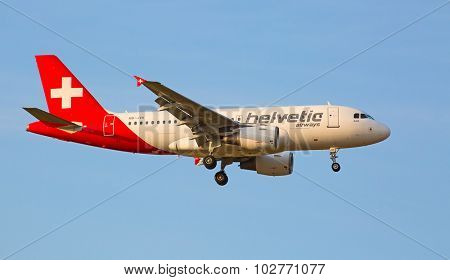 ZURICH - JULY 18: Helvetic airways A-319 landing in Zurich airport on July 18, 2015 in Zurich, Switzerland. Zurich airport is home port for Swiss Air and one of the biggest european hubs.