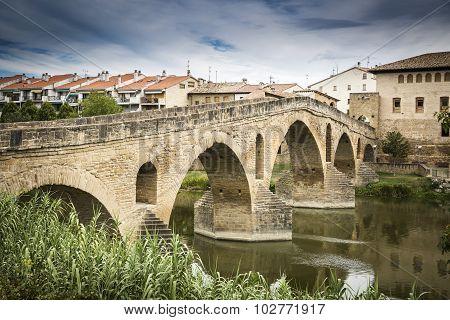 ancient Roman bridge over Arga river in Puente la Reina - Gares, Spain