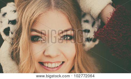Portrait Of Pretty Smiling Woman In Fur Earmuffs.