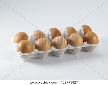 tray of eggs isolated on white background