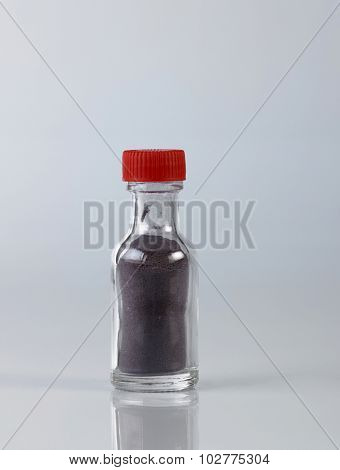 bottle of food coloring on the white background