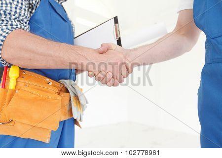 Workmen Handshake