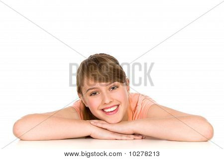 Young woman leaning on a table