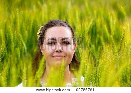 Young woman in rye field