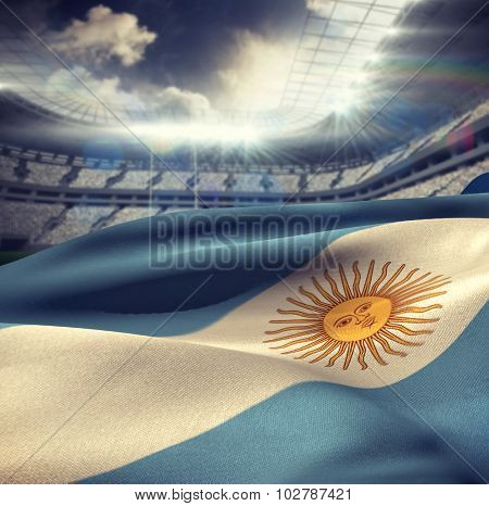 Argentina flag waving in wind against rugby stadium
