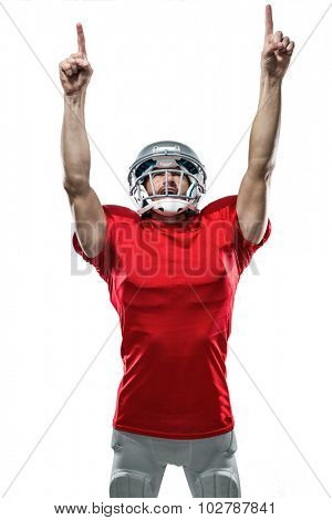 American football player looking up with arms raised standing against white background