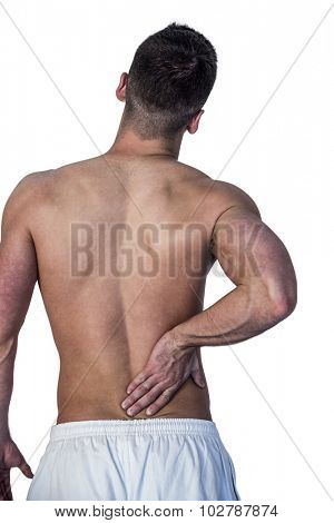 Rear view of man suffering from back pain against white background