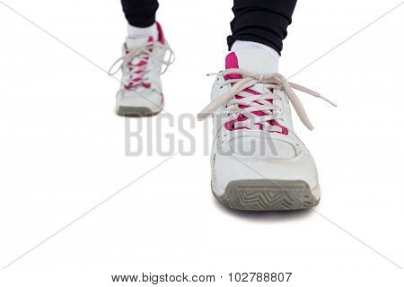 Low section of woman jogging against white background
