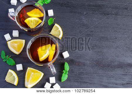 Black Tea With Lemon And Sugar On A Dark Background