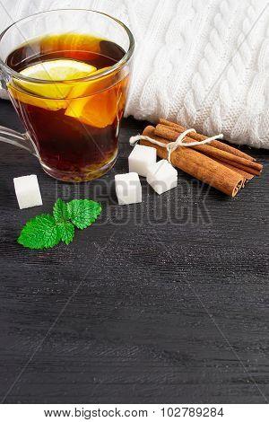 A Cup Of Black Tea With Lemon And Cinnamon