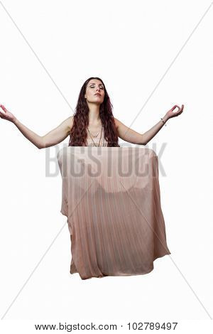 Portrait of woman levitating with eyes closed against white background