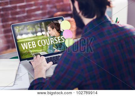 Web course ad against rear view of creative editor working on laptop