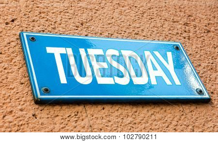 Tuesday blue sign