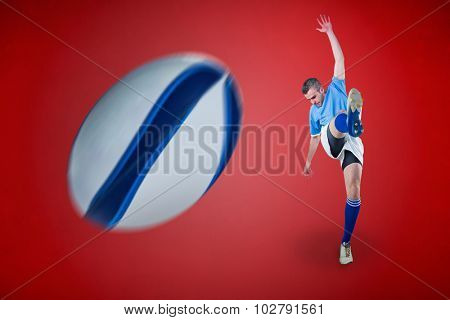Rugby player kicking against grey vignette