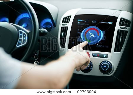 transport, modern technology and people concept - male hand setting sound volume level on car audio stereo system