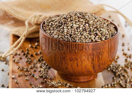 Hemp Seeds On A Wooden Table.