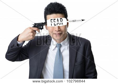 businessman use gun shoot word FEAR in his head isolated on white background Motivation concept