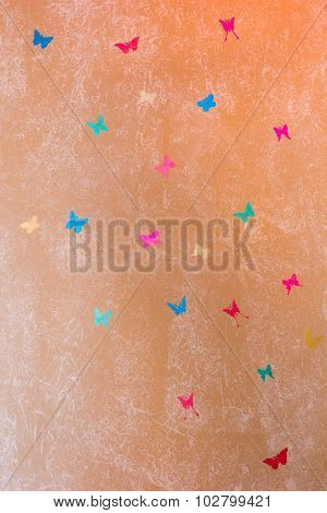 Beige Wall Painted With Textured Paint Roller With Butterflies