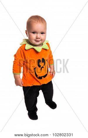 Toddler Dressed As A Pumpkin For Halloween