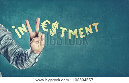 Word investment with fingers instead of letter V