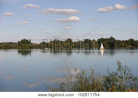 Reservoir with sailing yacht