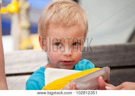 Little Boy And Corn On The Cob
