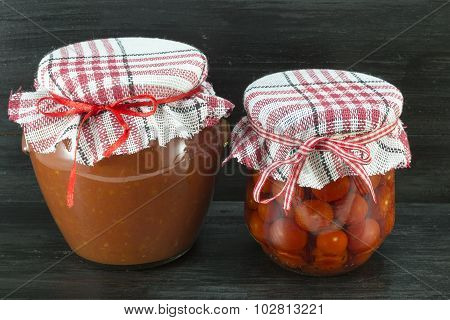 Jars Of Homemade Ketchup And Cherry Tomato