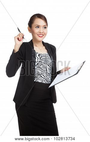 Young Asian Business Woman With Pen And Clipboard