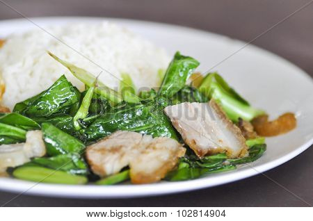 Stir Fried Kale With Crispy Pork And Rice