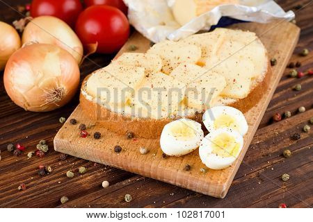 Bread With Butter And Slices Of Romadur Cheese And Eggs