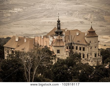 Jezeri castle and coal mine on a background