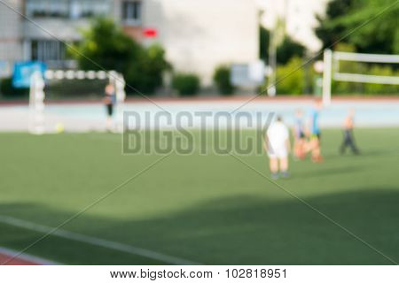 Blurred Green Football Field With Players 2
