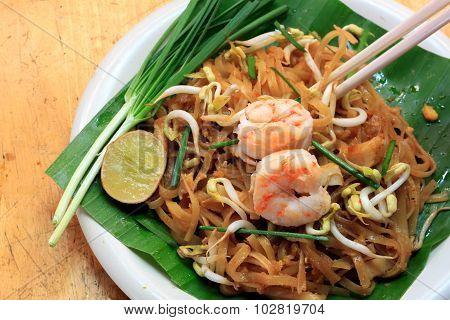 Thai noodle or padthai with garnish,vegetable, shrimp.
