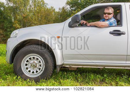 Man sitting in a car