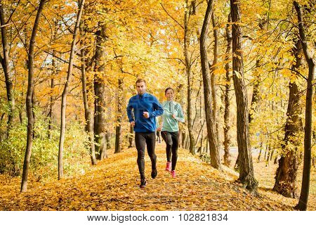 Couple running in autumn nature