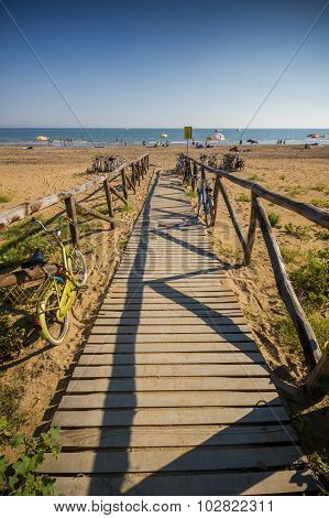 Nice wooden road to beach, sunny day
