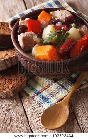 Eintopf With Meat, Sausages And Vegetables Close-up Vertical