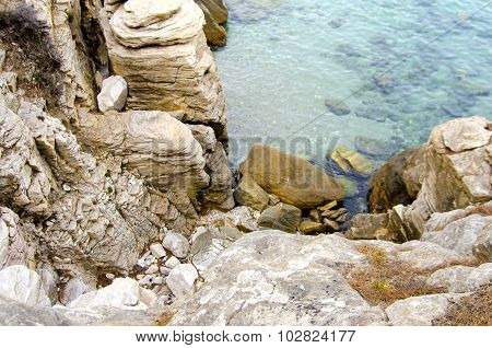 Rocky Beach And Clear Turquoise Water On Aegean Sea