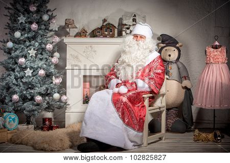 happy Santa Claus on the background of Christmas decorations