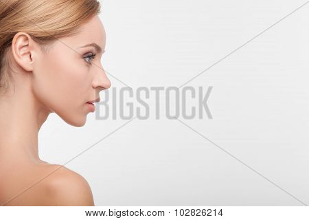 Cheerful healthy woman with smooth perfect skin