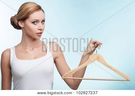 Cheerful young girl has nothing to wear
