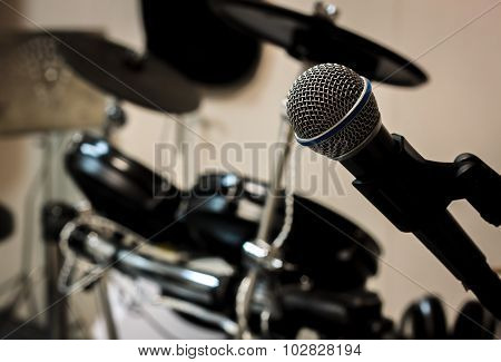 Microphone On Blur Drum Background And Vignetting.
