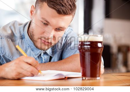 Cheerful young guy is working in pub
