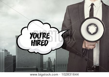 Youre hired text on speech bubble with businessman and megaphone