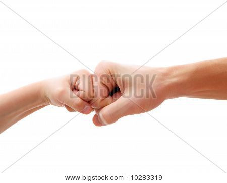isolated big little fists against each other